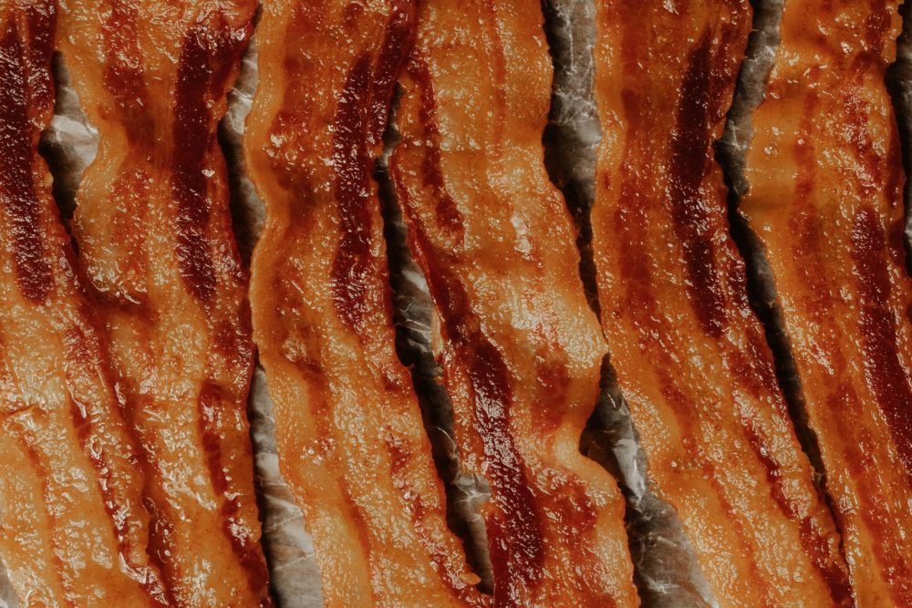 Sizzling cooked bacon about to go in fridge