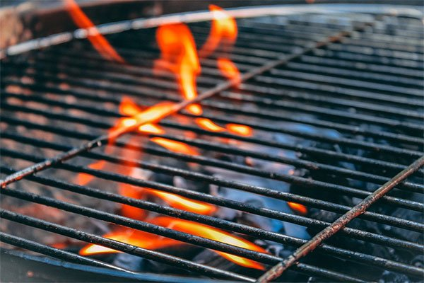 A burning flat top grill that needs cleaned